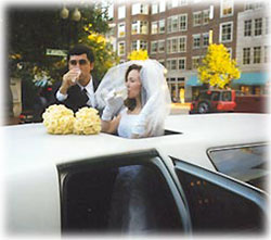 Married Couple Toasting Champagne through a Limo Moon Roof